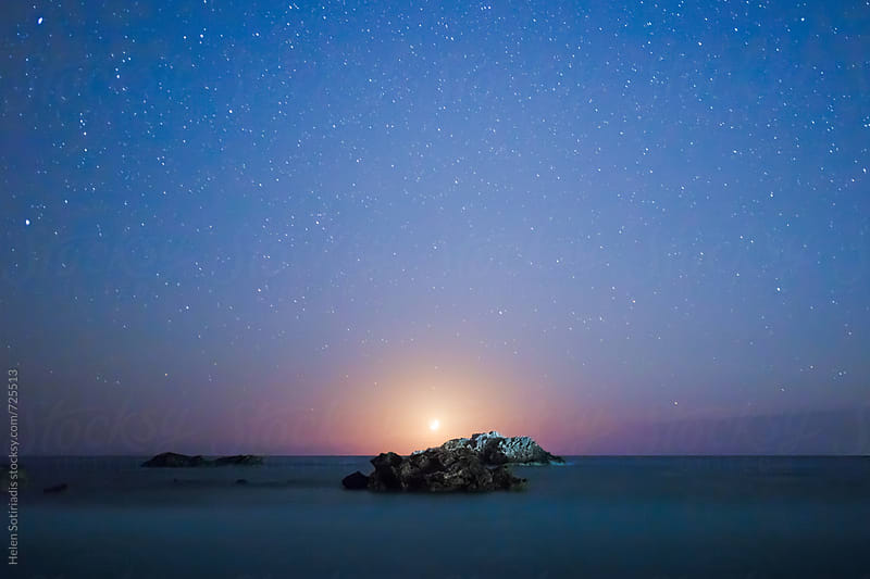 The Crescent Moon Sets behind a Rocky Seascape by Helen Sotiriadis for Stocksy United