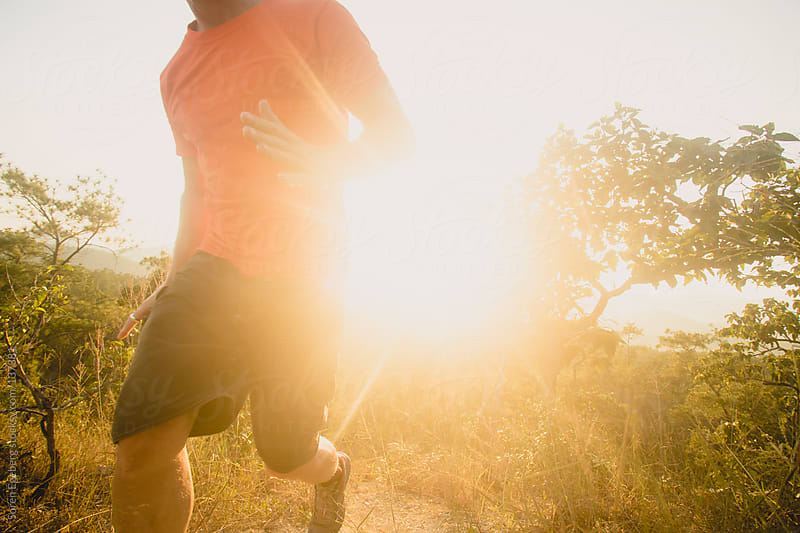 Runner outdoors at sunset by Soren Egeberg for Stocksy United