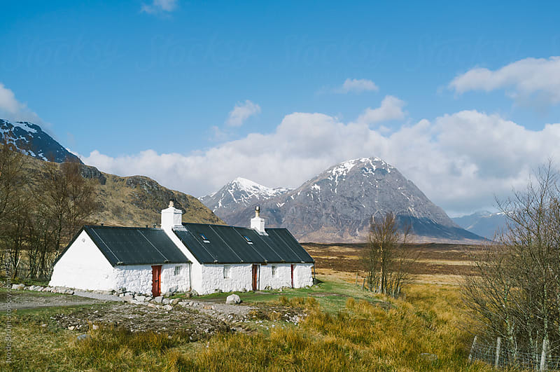 White house in the valley of the Scottish Highlands by Ivo de Bruijn for Stocksy United