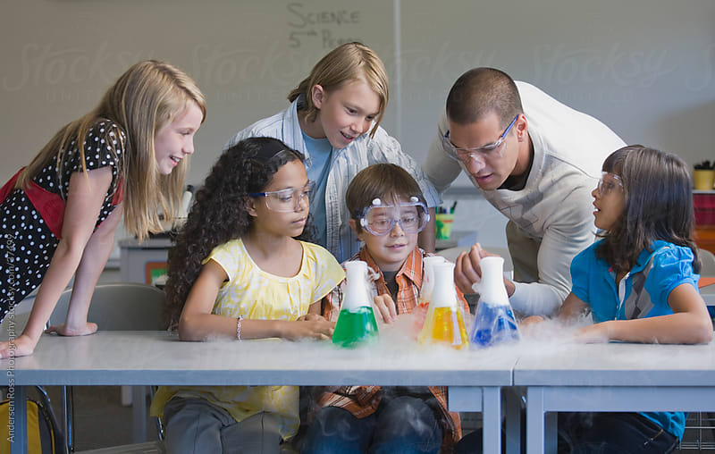 Children (10-11) and teacher at science class by Andersen Ross Photography for Stocksy United