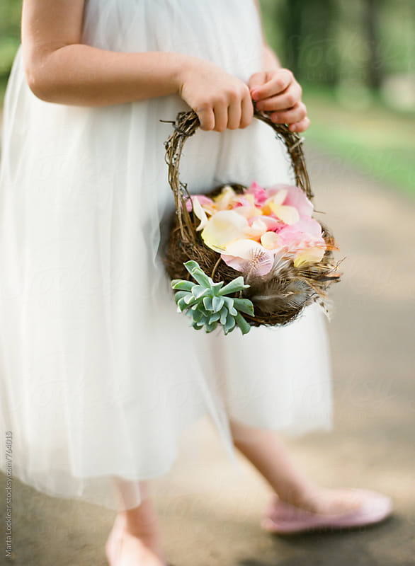 Flower girl & basket by Marta Locklear for Stocksy United