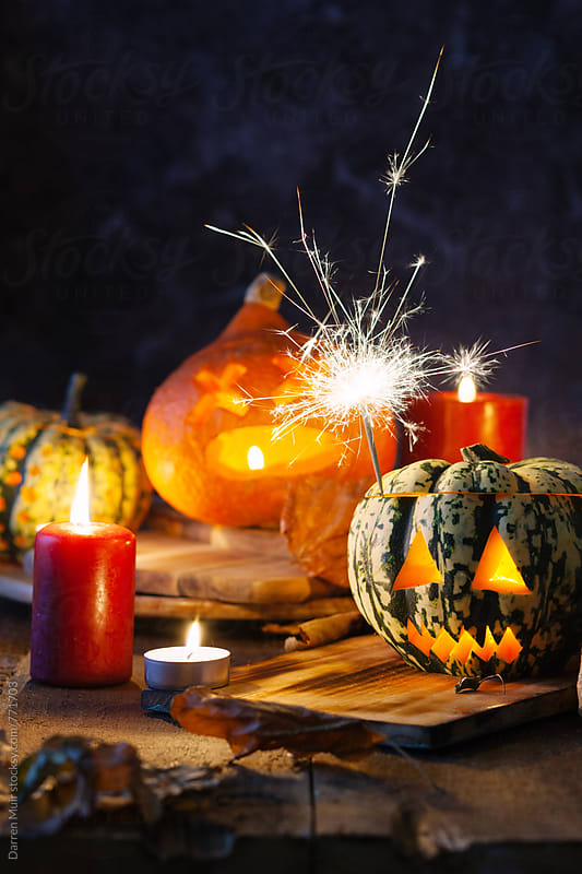 Halloween: Jack-o-lanterns with sparklers and candles. by Darren Muir for Stocksy United