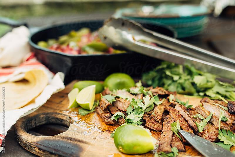 Sliced juicy grilled beef for fajitas by Gabriel (Gabi) Bucataru for Stocksy United