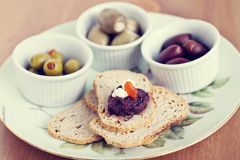 Food plate of olives by Kerry Murphy for Stocksy United