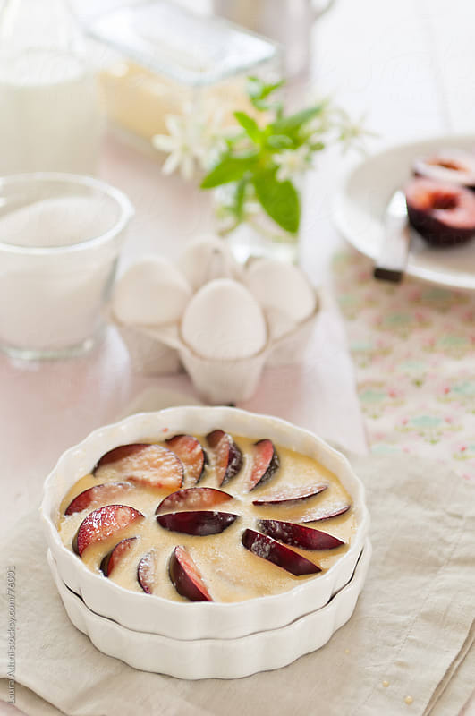 the clafoutis of plum, eggs and milk is ready for baking by Laura Adani for Stocksy United