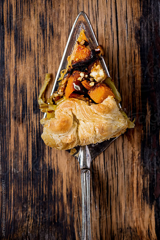 Slice of Roasted Squash and Leek Galette by Jeff Wasserman for Stocksy United