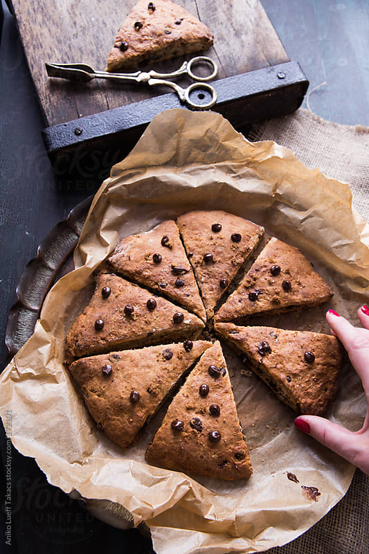 Banana Chocolate scones sprinkled with chocolate chips by Aniko Lueff Takacs for Stocksy United