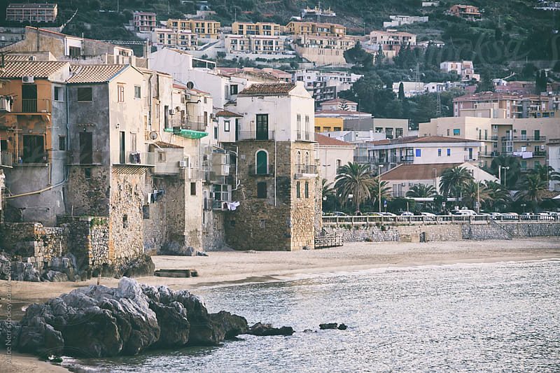 Vintage Sicilian houses right next to the sea water by Alice Nerr for Stocksy United