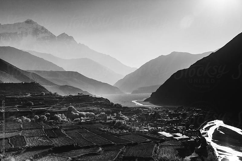 The landscape of Kagbeni beside Kali Gandaki river with Mt. Nilgiri towering behind it. by Shikhar Bhattarai for Stocksy United