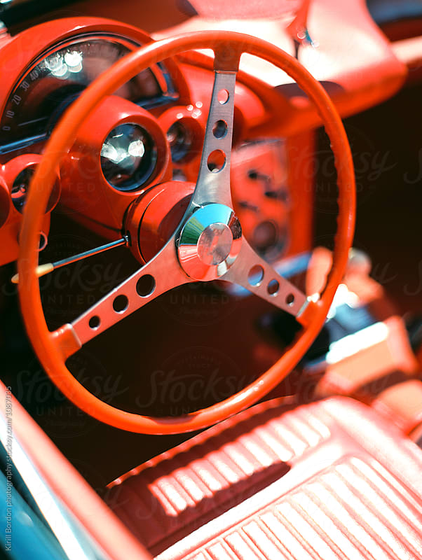 red interior of a classic car by Kirill Bordon photography for Stocksy United