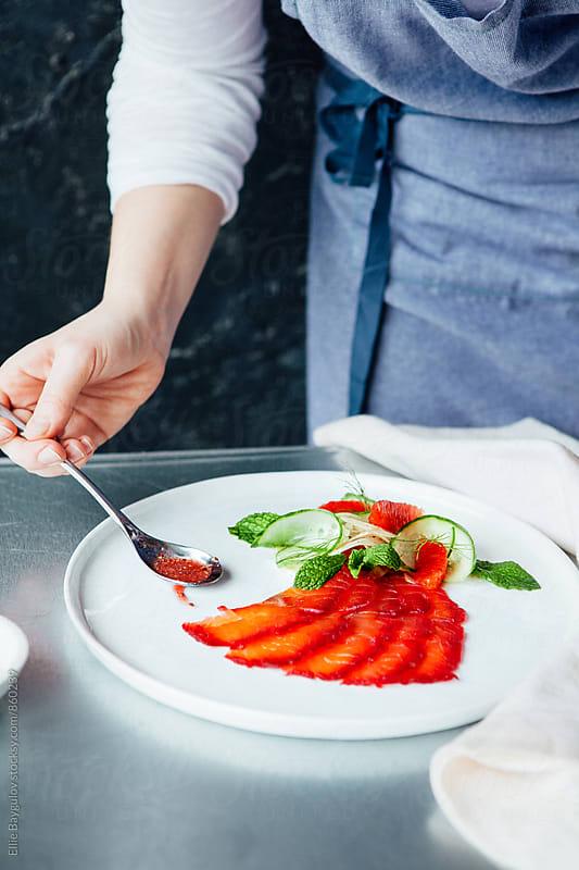 Beet cured salmon dish by Ellie Baygulov for Stocksy United