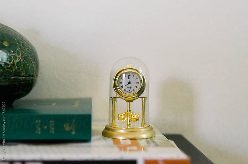 a miniature version of a classic clock, horizontal by Margaret Vincent for Stocksy United