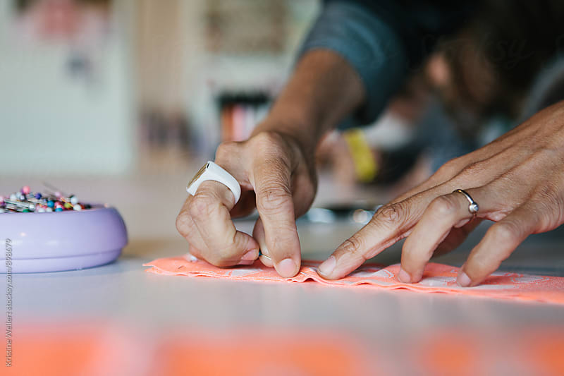 Womans Hands Working with Fabric by Kristine Weilert for Stocksy United