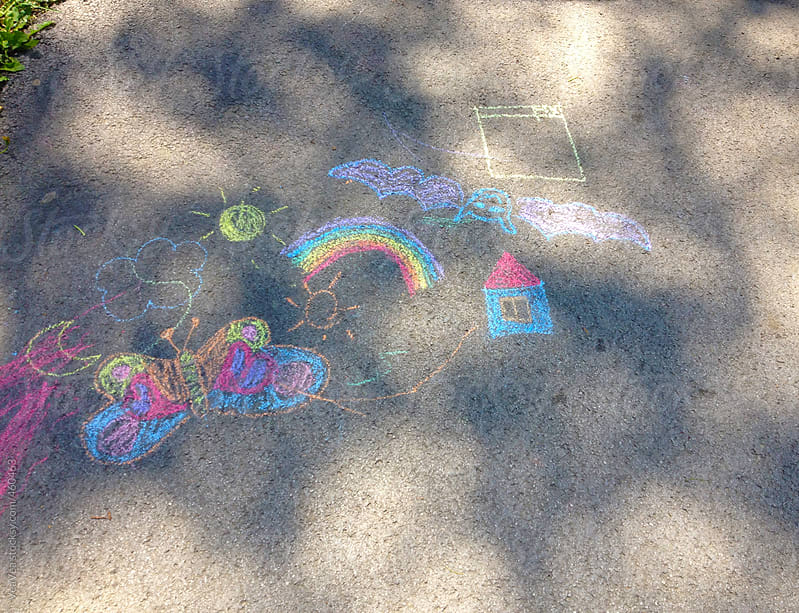 Child's chalk drawing on the street by VeaVea for Stocksy United