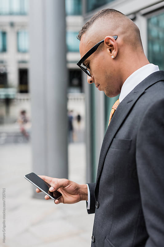 Businessman using mobile phone by Mauro Grigollo for Stocksy United