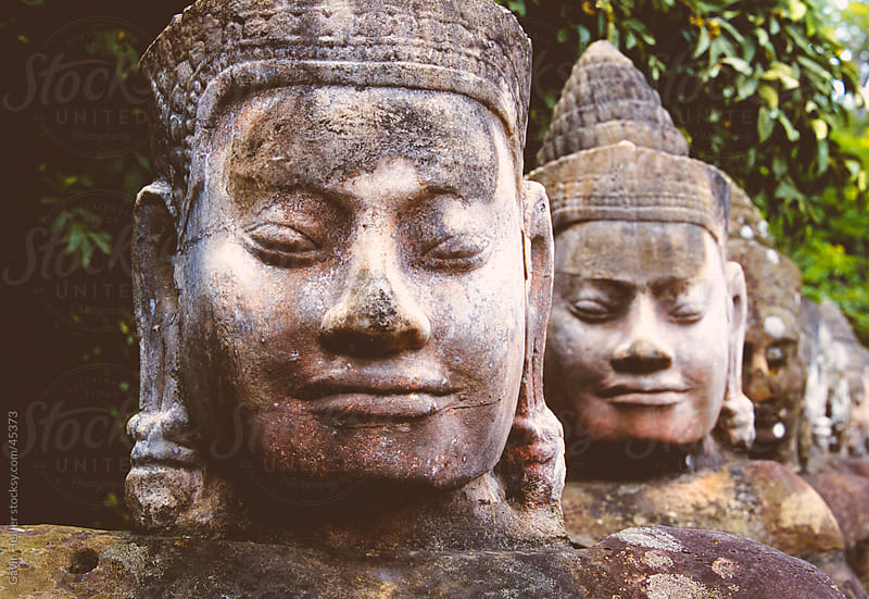 Stone heads lining the causeway en route to the Bayon Temple, Angkor Wat, Angkor, Cambodia by Gavin Hellier for Stocksy United