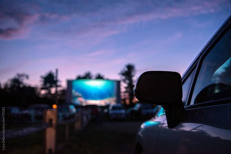 Dusk falls at the drive-in movie theatre by Cara Dolan for Stocksy United