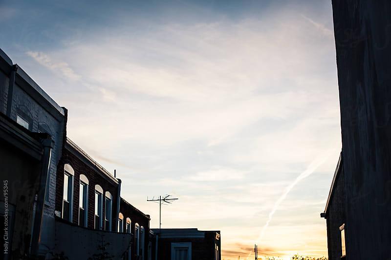 An autumn sunset over a Philadelphia neighborhood. by Holly Clark for Stocksy United