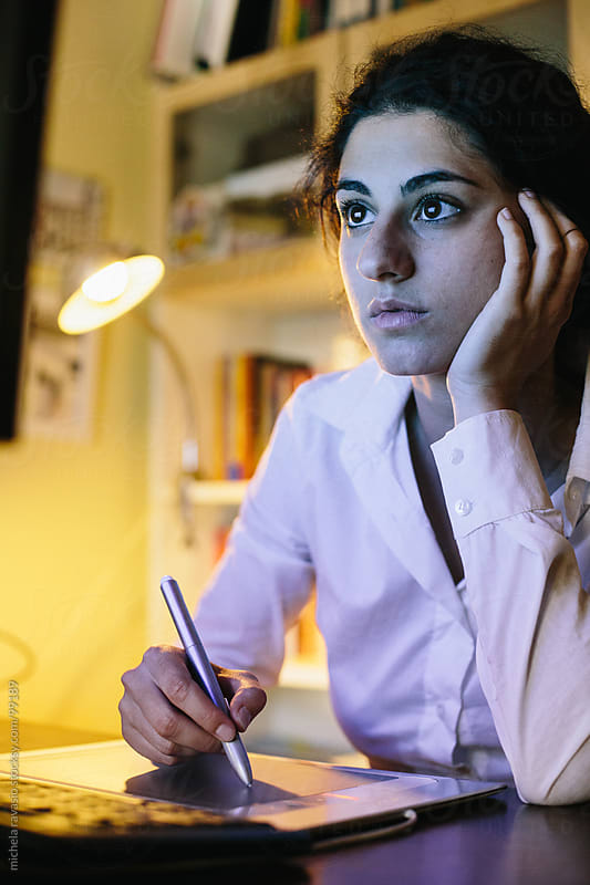 Young woman at the computer by michela ravasio for Stocksy United