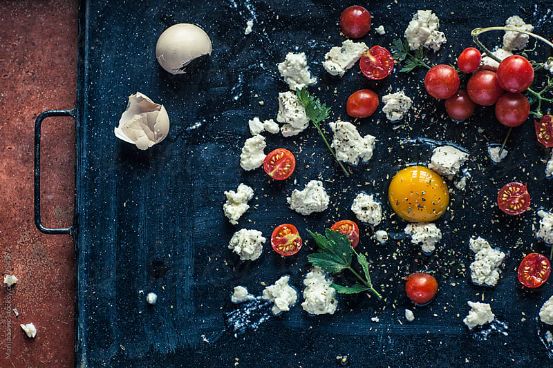 Eggs with Cheese and Cherry Tomatoes by Marija Savic for Stocksy United