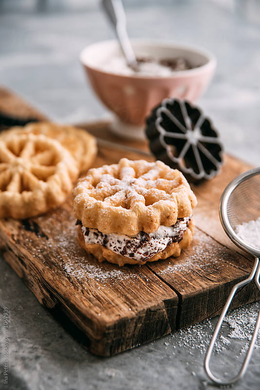 Food: South Italian dessert, Baci Panteschi, deep fried waffles with sweetened ricotta chocolate filling by Ina Peters for Stocksy United
