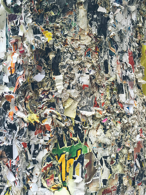 Layer upon layer of peeling posters on telephone pole, close up by Paul Edmondson for Stocksy United