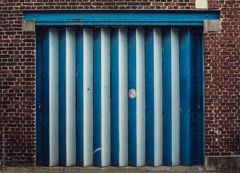 Blue Garagge Door  by Mosuno for Stocksy United