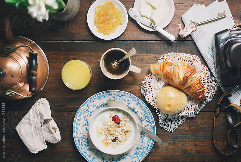 Breakfast with tea orange jucie and croissant. by mee productions for Stocksy United