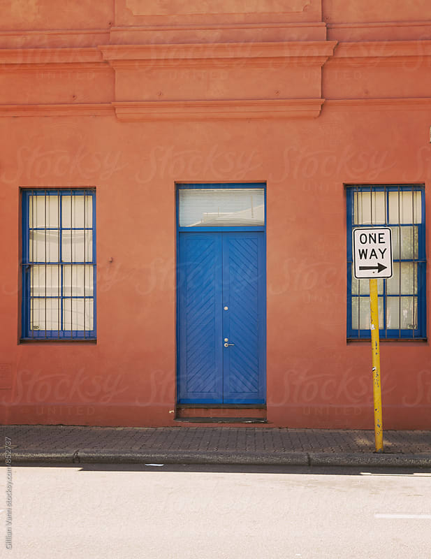 blue door in an old building by Gillian Vann for Stocksy United
