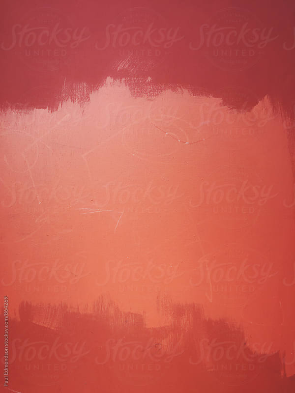 Orange and red paint covering graffiti tag on wall by Paul Edmondson for Stocksy United