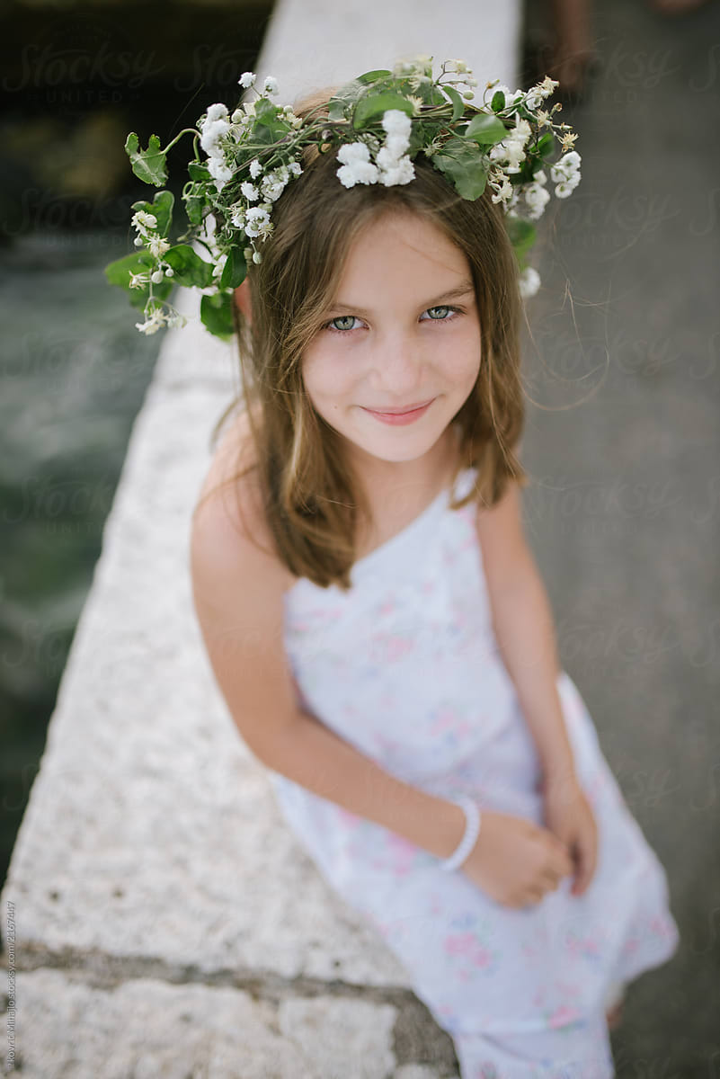Young girl with flower crown stocksy united young girl with flower crown by mihajlo ckovric for stocksy united izmirmasajfo