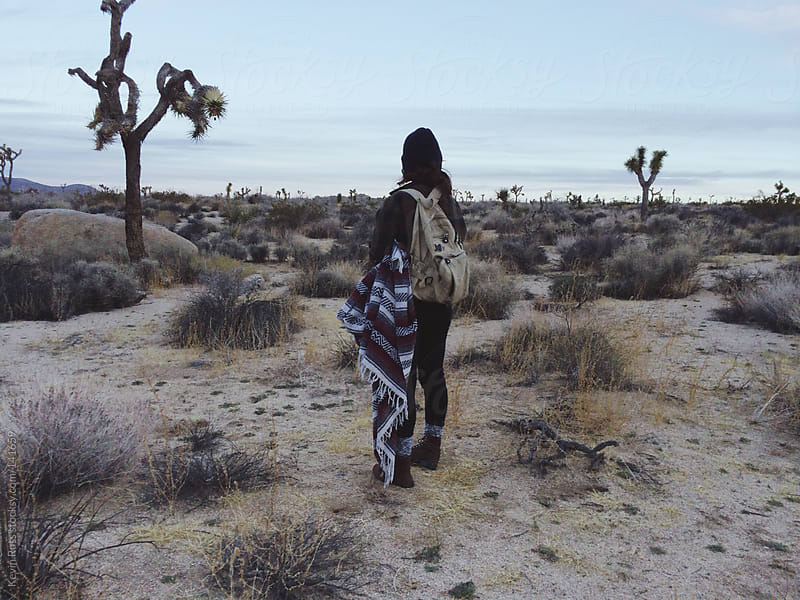 Woman Standing in the Desert by Kevin Russ for Stocksy United