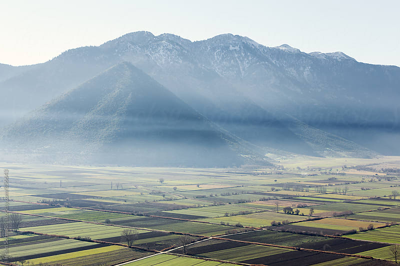 Mountains and Fields under Haze by Helen Sotiriadis for Stocksy United