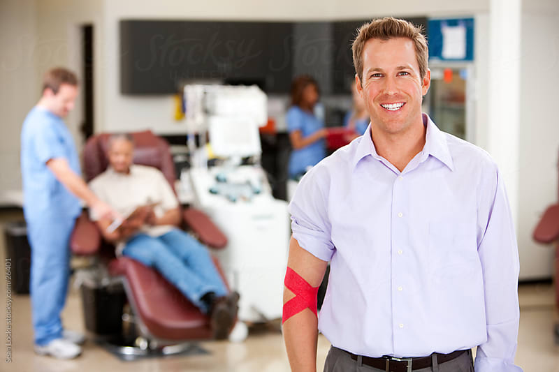 Blood Bank: Cheerful Blood Donor After Donation by Sean Locke for Stocksy United