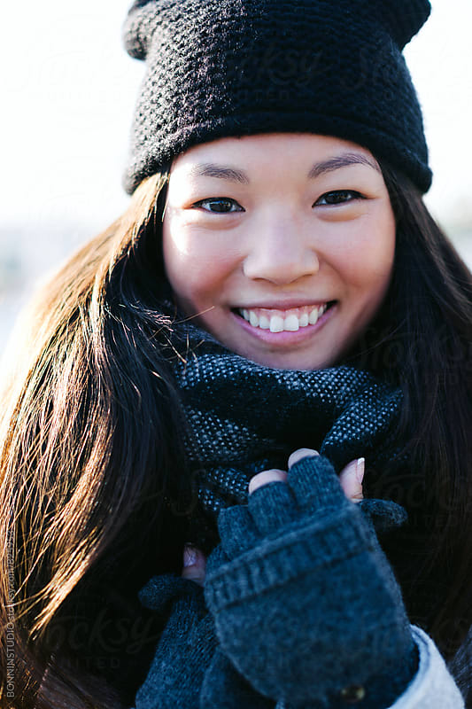 Portrait of a smiling chinese woman wearing winter clothes. by BONNINSTUDIO for Stocksy United