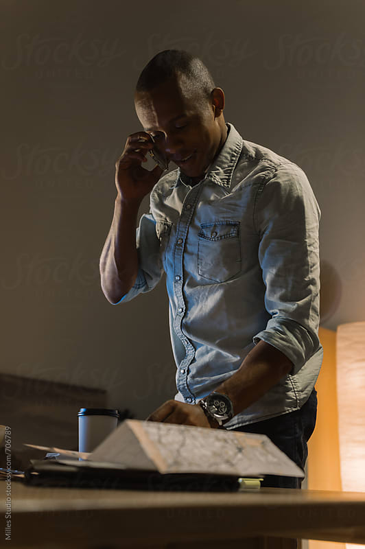 Man working with phone by Milles Studio for Stocksy United