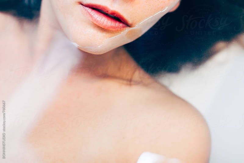 Macro of a woman relaxing in the bathtub. by BONNINSTUDIO for Stocksy United