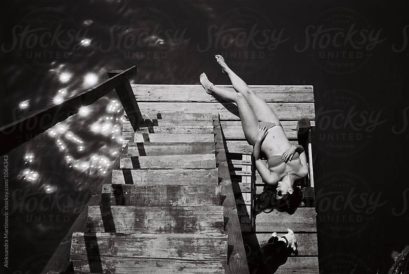 Lying on the dock by Aleksandra Martinovic for Stocksy United