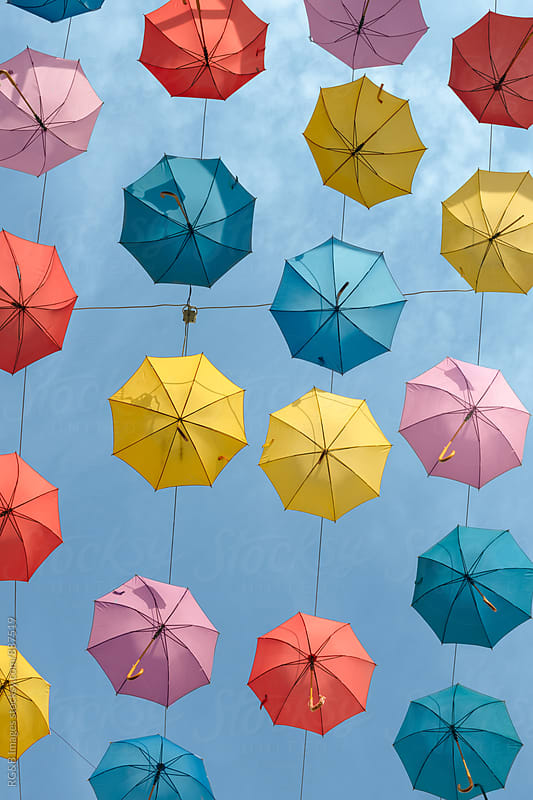 Colorful umbrellas suspended in the sky by RG&B Images for Stocksy United