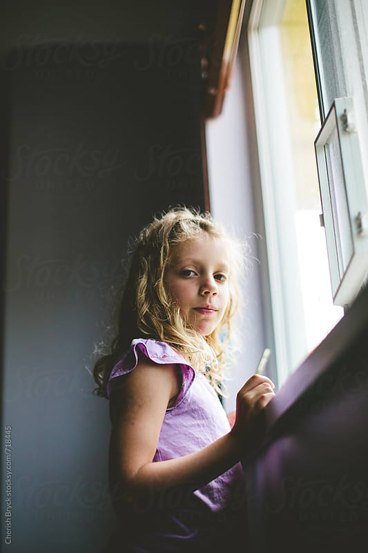 Girl at the window. by Cherish Bryck for Stocksy United