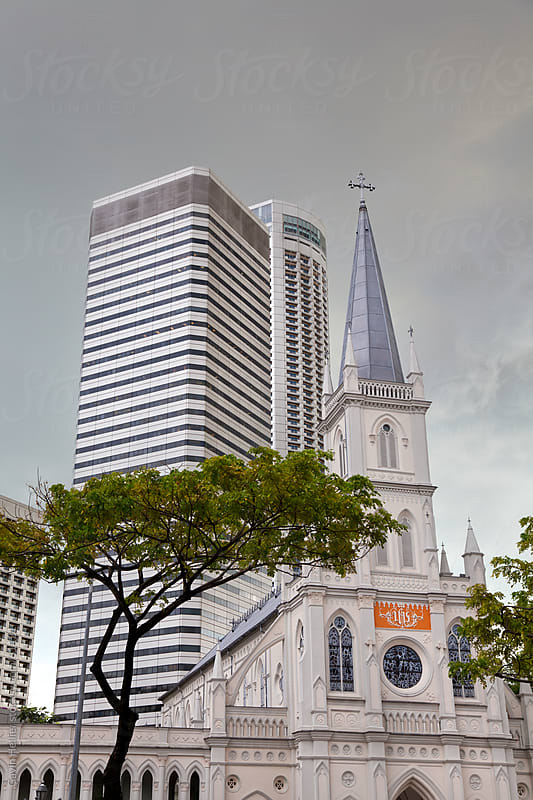 South East Asia, Singapore, Cathedral of the Good Shepard and modern hotel architecture by Gavin Hellier for Stocksy United