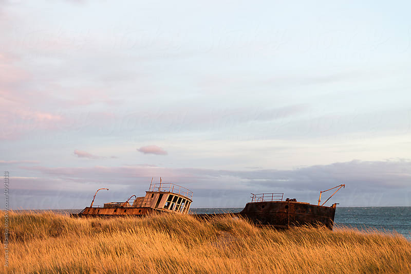 Shipwreck stranded on the shore in Strait of Magellan by Jovana Milanko for Stocksy United