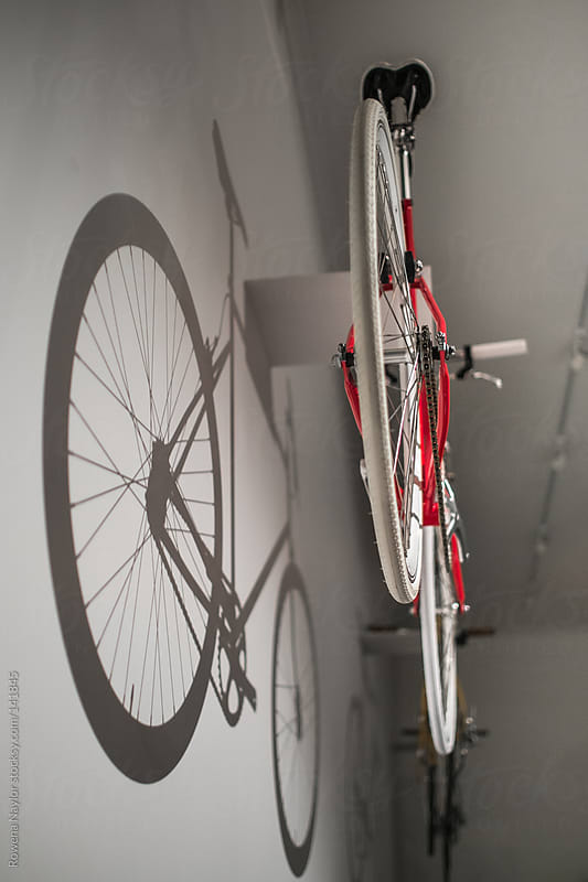 Shadow of a Bike hanging on wall by Rowena Naylor for Stocksy United