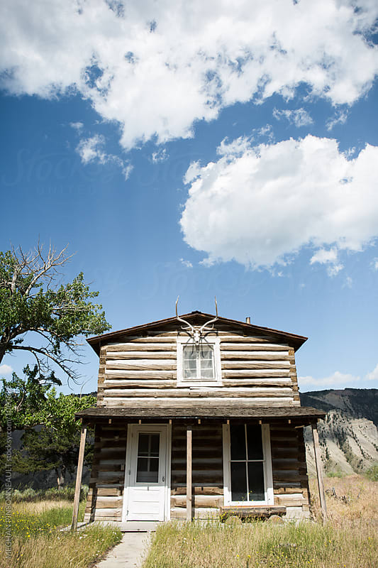 Historic Log Cabin with Skull and Antlers  by MEGHAN PINSONNEAULT for Stocksy United