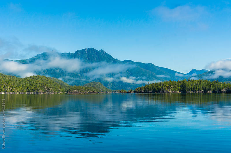 Low clouds and fog over a lake by Richard Brown for Stocksy United