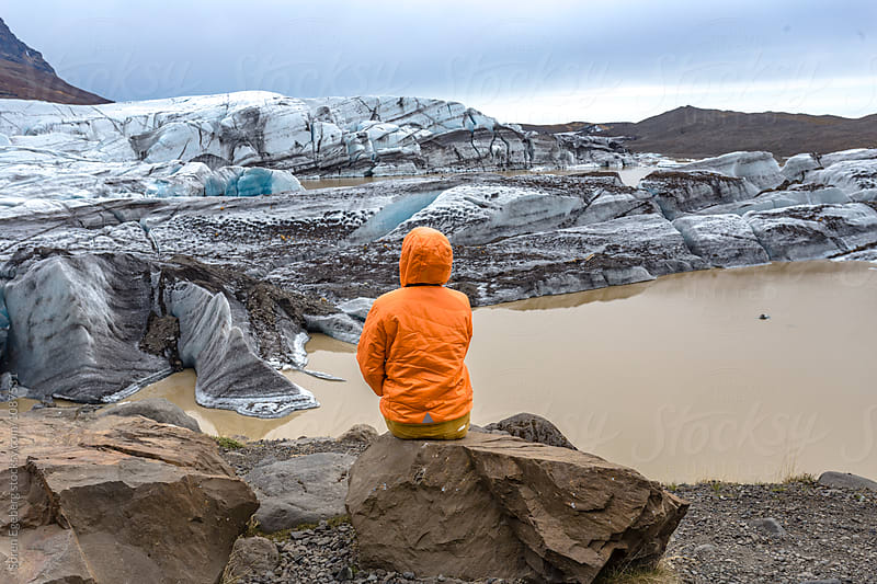 Woman enjoying view of glacier landsape in Iceland by Søren Egeberg Photography for Stocksy United