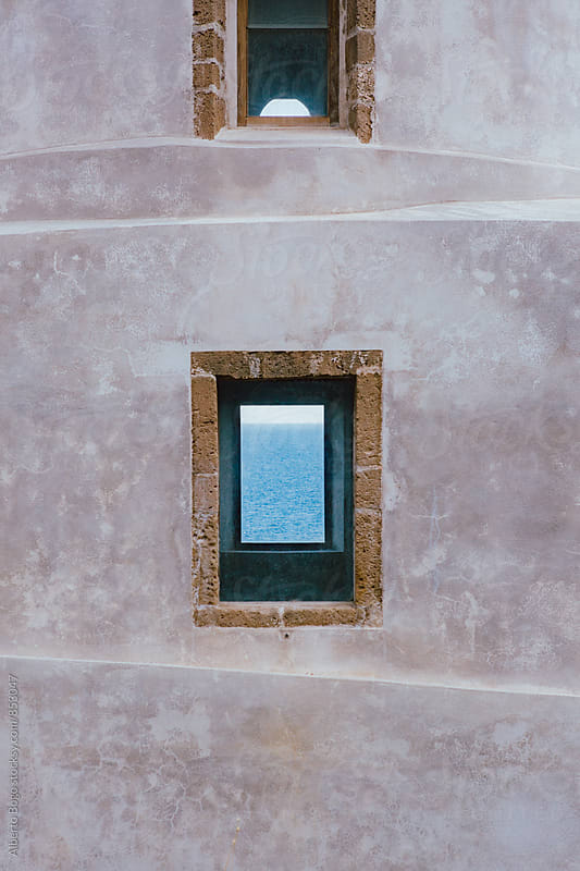 A wall and window with a sea. by Alberto Bogo for Stocksy United