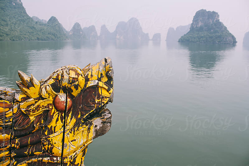 Dragon head on front of a ship navigating on Halong Bay, Vietnam by Alejandro Moreno de Carlos for Stocksy United