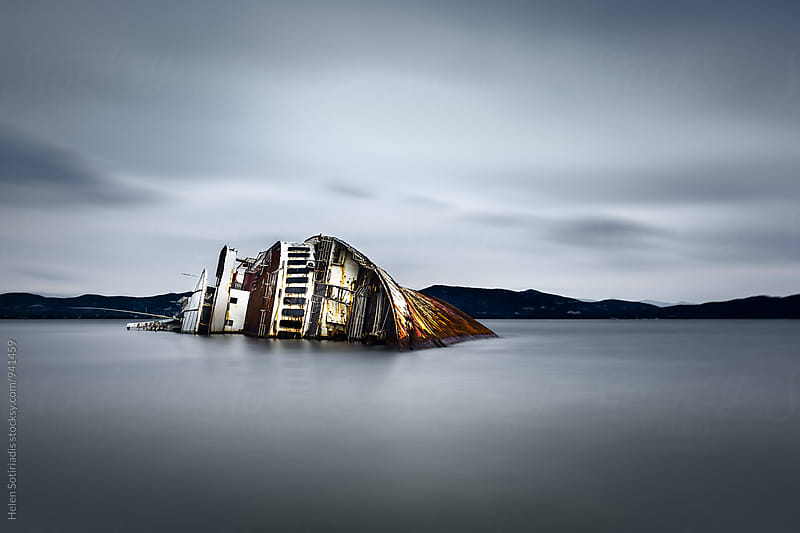 Long Exposure Seascape with Shipwreck by Helen Sotiriadis for Stocksy United