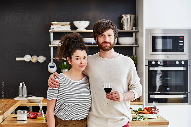 Couple Holding Wineglass In Kitchen by ALTO IMAGES for Stocksy United